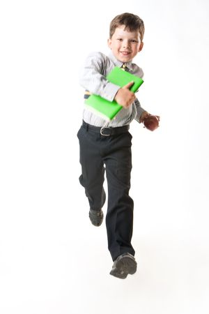 attitude boy: Photo of happy youngster running for a lesson at school on white background Stock Photo