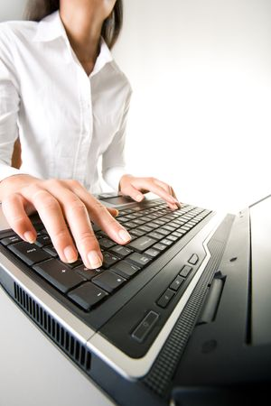 Photo of executive businesswoman�s hands on keyboard of laptop while typing documents photo