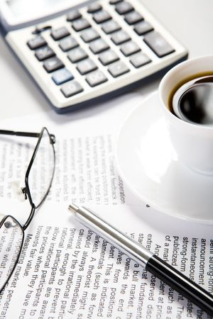 everyday jobs: Image of workplace at morning: cup of coffee, documents, pen and glasses    Stock Photo