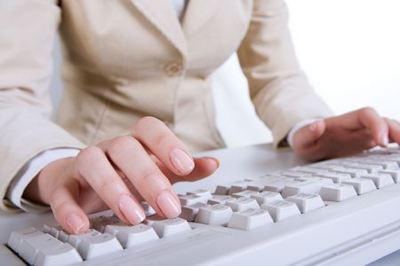 Close-up of female�s hands above keyboard during typing  photo