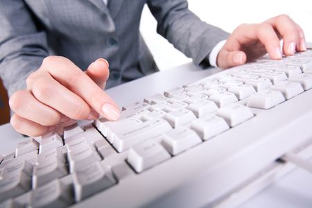 Image of secretary's hands while pressing enter button during computer work Stock Photo - 3387265