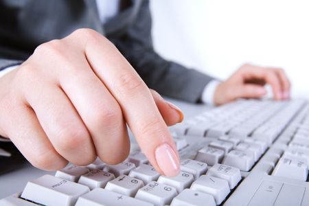 Macro image of human hand with forefinger going to press key on keyboard Stock Photo - 3387268