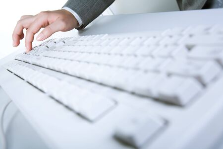 Image of white keyboard with human hand pressing button on it Stock Photo - 3387260