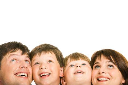 looking upwards: Photo of happy family looking upwards on white background