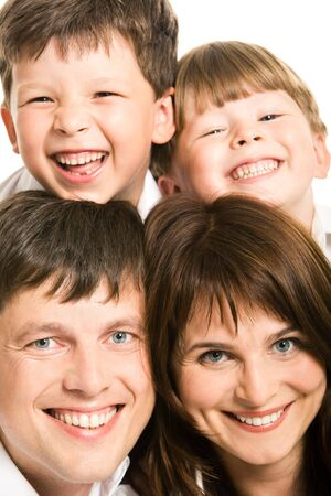 Photo of smiling father, mother and two siblings looking at camera Stock Photo - 3421187