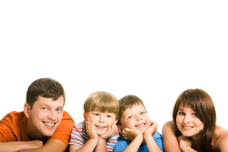 Row of cheerful family members lying and looking at camera with smiles Stock Photo - 3421132