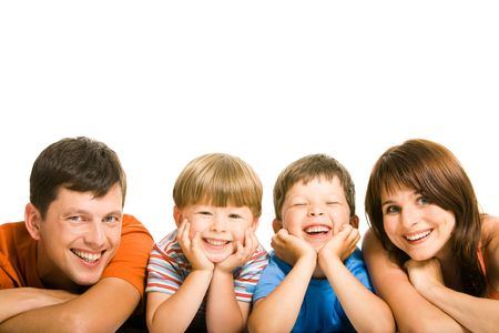 people laughing: Row of family members lying on the floor Stock Photo
