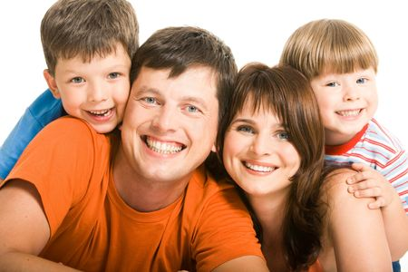 Portrait of joyful family laughing and looking at camera on white background Stock Photo - 3421186