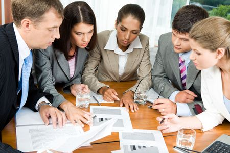 Image of five people looking at business-plan and brainstorming photo