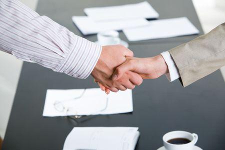 confirmed: Image of successful partnership of people being confirmed by handshake