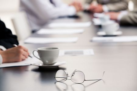 Image of  glasses placed on the table during a seminar  photo