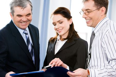 Business group of three people discussing plan at meeting   photo