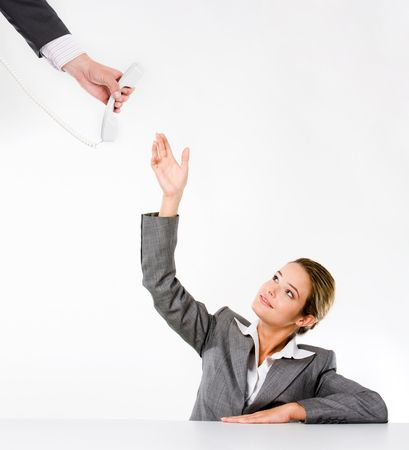 Photo of confident secretary raising her hand to take telephone receiver being held by man photo