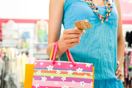 Image of female holding card in hand ready to pay for her shopping Stock Photo - 3515020