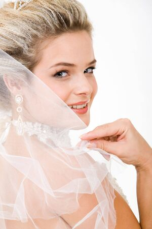 Photo of happy bride touching her veil and looking at camera with smile Stock Photo - 3516080