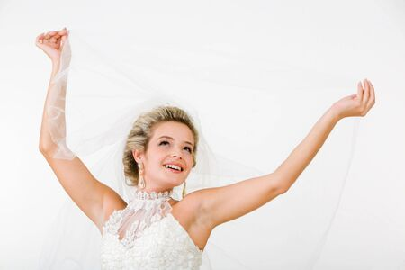 fiancee: Portray of happy beautiful fiancee raising hands with veil