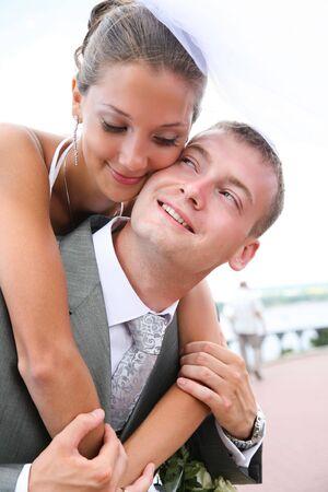 fiance: Portrait of affectionate bride embracing tenderly her husband during wedding