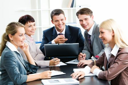 Photo of business group sitting at workplace and looking at successful woman touching papers photo