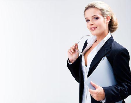 beautiful teacher: Portrait of beautiful teacher holding glasses and folder on a white background   Stock Photo