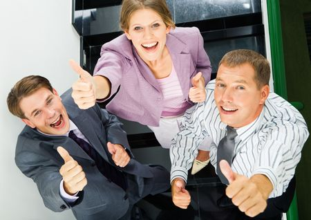 Portrait of business people giving the thumbs-up sign Stock Photo - 3522189