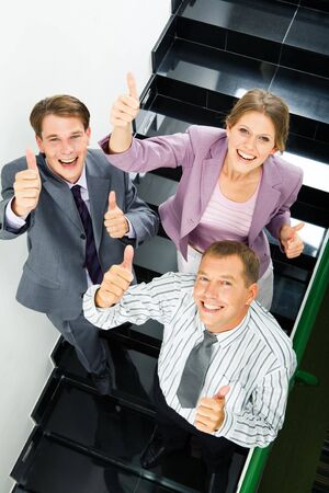 Portrait of businesspeople showing sign of okay  photo