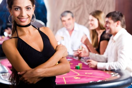 Portrait of fashion woman in black dress in the casino  photo