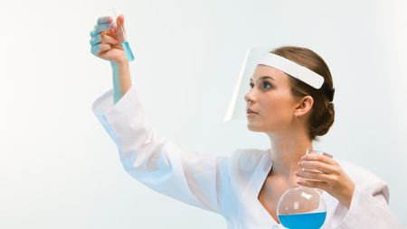 Portrait of medical specialist looking at flask on a white background  photo