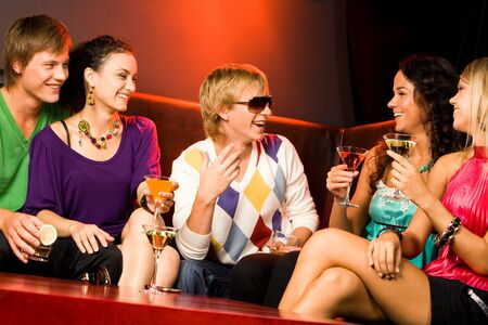 Image of happy teenagers holding the cocktails and chatting Stock Photo - 3545352