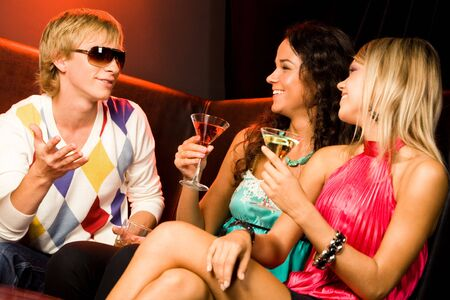 Portrait of handsome man speaking something to pretty women at party   Stock Photo - 3545344
