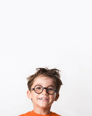 Image of happy child with tousled hair looking at camera with smile photo