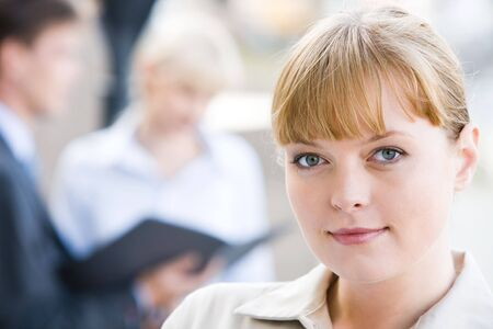 Close-up of charming lady in working environment photo