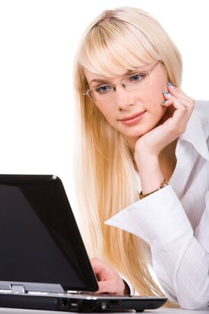 Portrait of lovely lady in front of laptop touching her face photo
