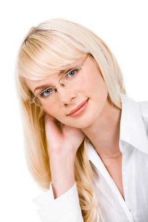 Portrait of charming lady in glasses touching her hair and looking at camera photo
