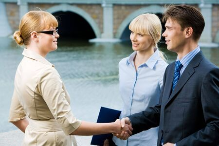 Portrait of business partners handshaking at meeting and looking at each other Stock Photo - 3709065