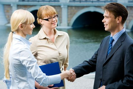 concluding: Photo of happy partners expressing trust by handshake after concluding bargain Stock Photo