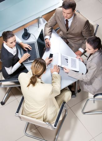 View from above of serious business group working at table in office Stock Photo - 3708994