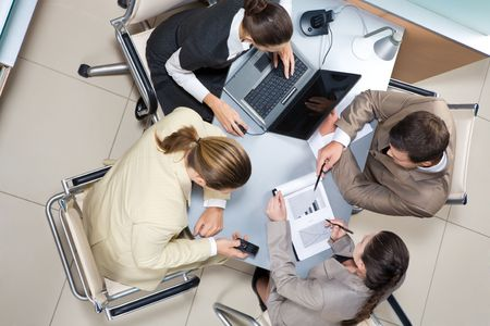 Above view of executive business group sitting at desk in office and busy working Stock Photo - 3708998