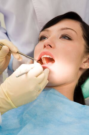 Close-up of inspection of oral cavity with help of hook and mirror Stock Photo - 3708150