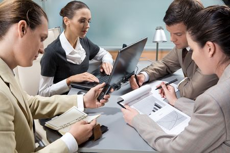 Photo of executive business partners around table interacting with each other Stock Photo - 3709000
