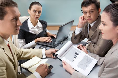 Image of confident colleagues interacting during appointment Stock Photo - 3708999