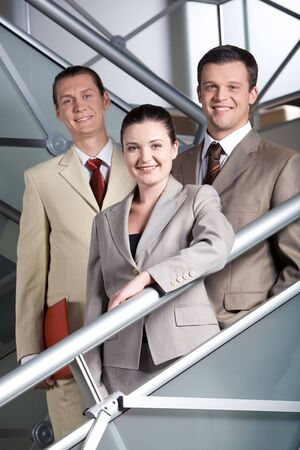 Portrait of three associates looking at camera with smiles photo
