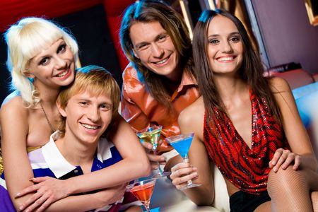 Portrait of happy friends gathered together in night club to have a party Stock Photo - 3709006