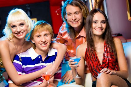 Portrait of friendly young people looking at camera with smiles in the bar photo