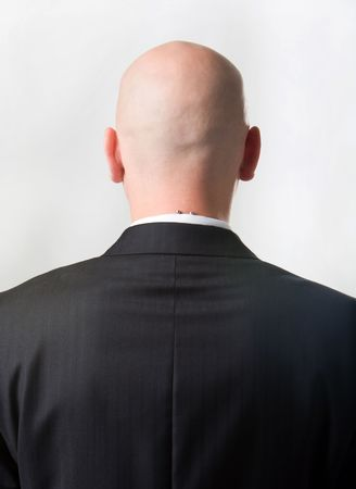 Rear view of bald man wearing suit over white background