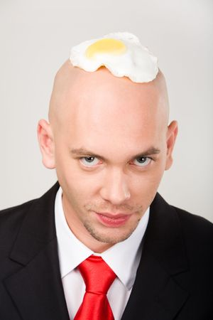 sunnyside: Bald man with fried eggs on top of head looking at camera Stock Photo