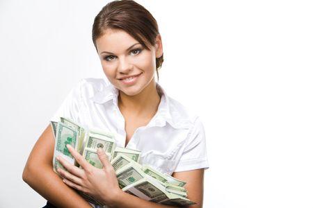 cash in hand: Retrato de mujer encantadora celebraci�n de d�lares y mirando la c�mara con sonrisa Foto de archivo
