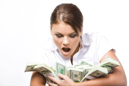 expressing: Photo of young woman afraid of losing money being held by her  Stock Photo