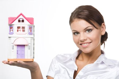 Image of pretty woman holding toy house on her palm photo