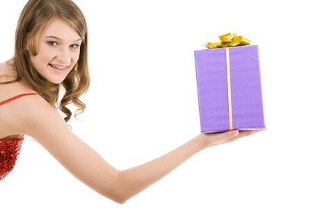 Photo of young beautiful woman making a present  photo