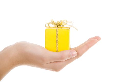 Image of small yellow box placed on human palm   photo
